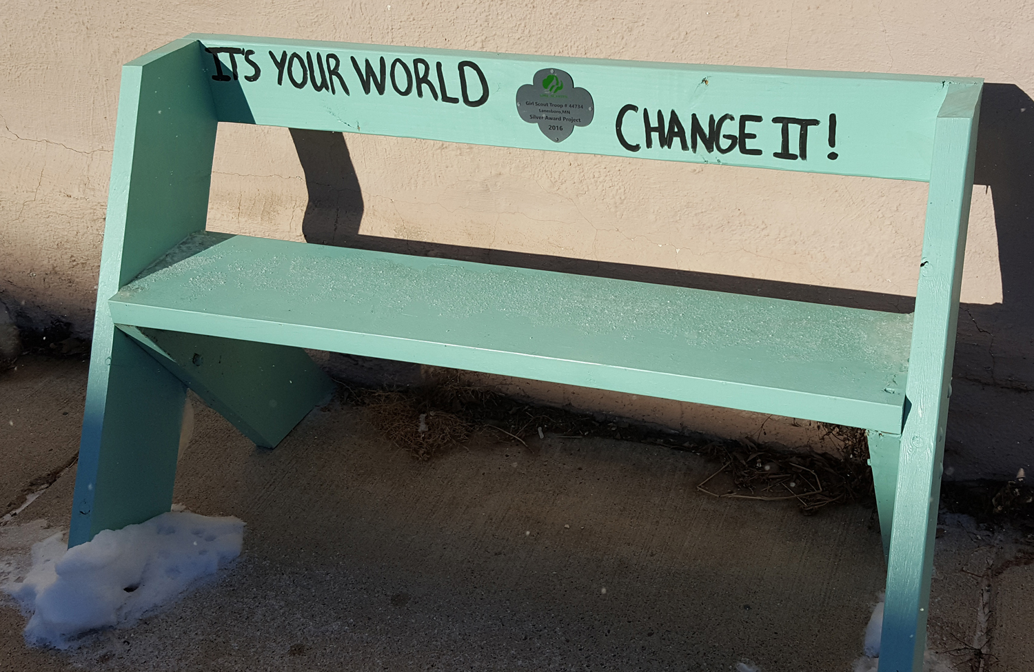 A bench in Lanesboro, Minnesota, says it all: It's your world, change it!