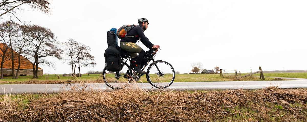Musician and poet Ben Weaver rides his bike across a European landscape.